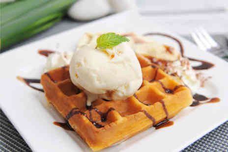 Trifles Bakery - Hot Belgian waffles or fudge cake with ice cream for 2 plus a hot chocolate or milkshake  - Save 54%