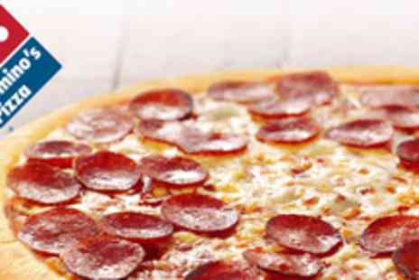 Dominos Pizza - A medium pizza with your choice of toppings from your local - Save 94%