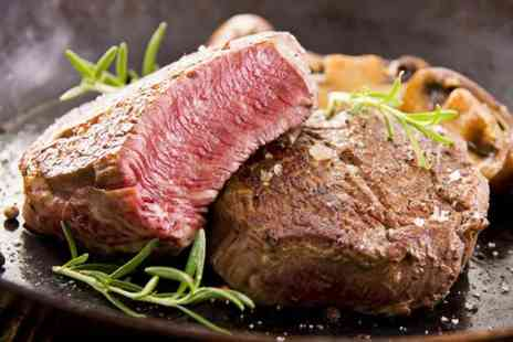 Rangos - Eight oz hot stone steak dinner for 2 including side dish & glass of wine - Save 51%