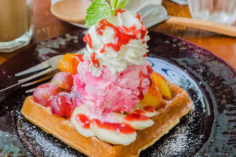 Delhi Deli Indian Cafe - Hot Waffle with Two Scoops of New Forest Ice Cream Bananas Sprinkles and Syrup with Large Hot Drink Each for Two People - Save 51%