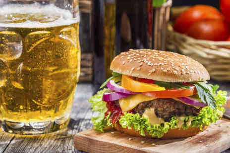 Henleys Sports Bar and Grill - Any Burger with Side of Chips and Beer or Soft Drink Each for Two - Save 58%