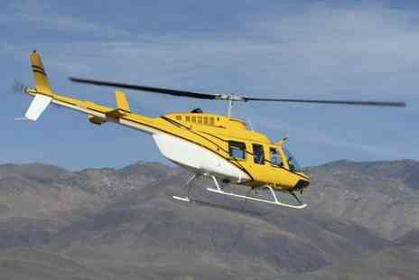 Whizzard Helicopters -  Eight mile Flight With Champagne and Chocolates - Save 51%