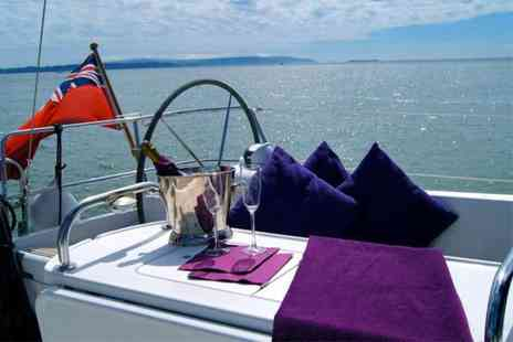 Escape Yachting - Half day Solent  sailing trip for 2 including two course meal and Champagne