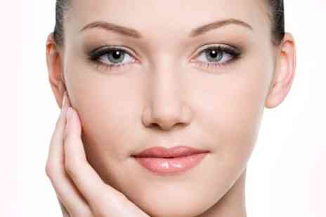 REM Laser Clinic - Three  Sessions of Laser Skin Treatment  For Choice of Area  - Save 52%