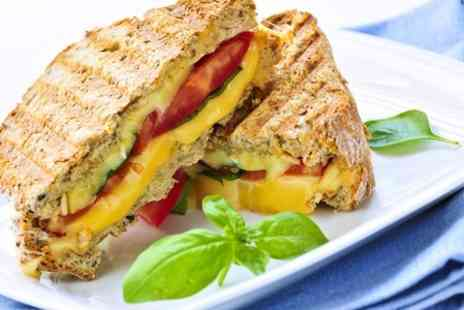 Treat Boutique - Panini or Baked Potato With Drink and Crisps - Save 54%