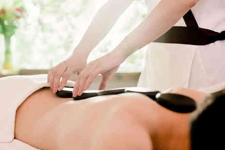 Soul and Beauty - Hour Long Full Body Hot Stone Massage or Hour Long Full Body Swedish Massage - Save 65%