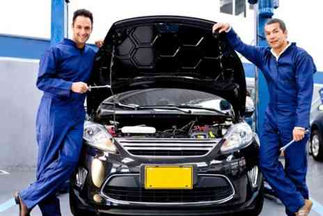 Trade Motors Direct - 52 Point Car Service Including Oil Change and Pick Up - Save 73%