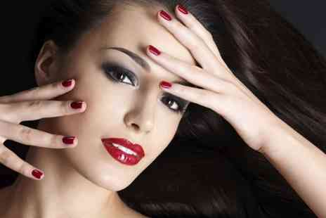 Indulge Tanning and Beauty . - Shellac Manicure or Pedicure - Save 55%