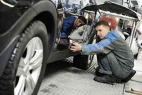 Trade Motors Direct -  52 point winter service, including an anti freeze top up, plus an oil & filter change - Save 81%