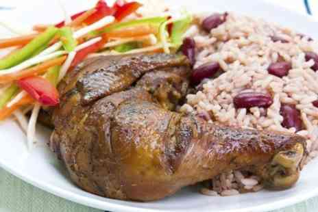 Carib Grill Caribbean Restaurant - Jerk Chicken For Two With Standard Sides and Rum Punch - Save 50%