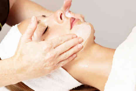 Freedom Beauty - Hour Long Facial or 45 Minute Hot Stone Massage - Save 53%