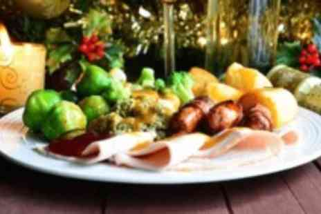Sackville Lounge - Three course Christmas lunch dinner with all the trimmings & a glass of wine for two - Save 60%