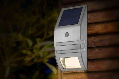 NiftySpot - LED Solar Light with Motion Sensor in Stainless Steel or Matte Black - Save 62%
