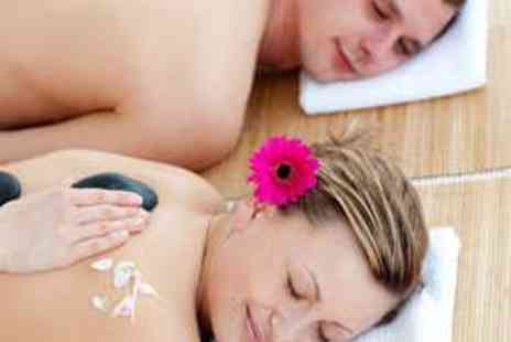 Purity Spa - Massage, Mani or Pedi, and Full Spa Use for Two - Save 75%
