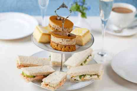 Hollin Hall Hotel - Afternoon tea with a glass of bubbly each for four - Save 56%