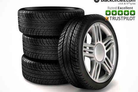 black circles - £50  to Spend on Four Fitted Tyres  - Save 80%
