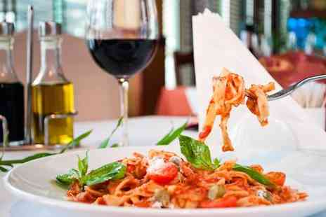 La Caverna Italian Restaurant - Three course meal & a glass of wine for two - Save 72%