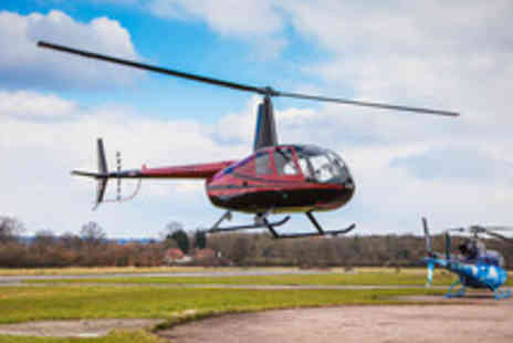 Heliservices - 30 Minute Helicopter Flying Lesson - Save 56%