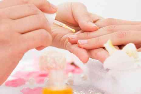 The Relaxation Den - Hand and Foot Massage, File and Polish and Eyebrow Shape - Save 50%