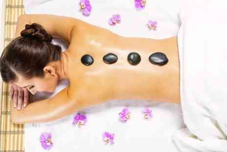 Peppermint Salon - Hot Stone Massage and Facial - Save 57%