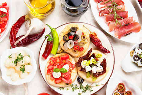 Rosa Twelve - Four Tapas Between Two with a Cocktail Each - Save 61%