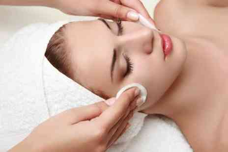 Oasis Beauty Clinic - One session of Diamond Microdermabrasion or a CACI Future Tec treatment & mini facial - Save 0%