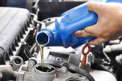 MCL Auto Centre - Car Oil Service Including 50 Point Safety Check, Oil Change, and Official Book Stamp - Save 76%