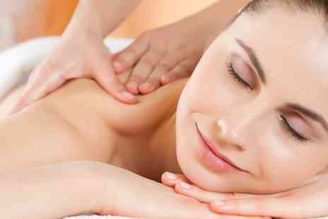 Noir Holistic Therapy - Facial With Hot Stone Back or Full Body Massage  - Save 60%
