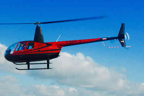 Flying Pig Helicopters - Helicopter flying experience for 2 people plus chocolates  - Save 50%