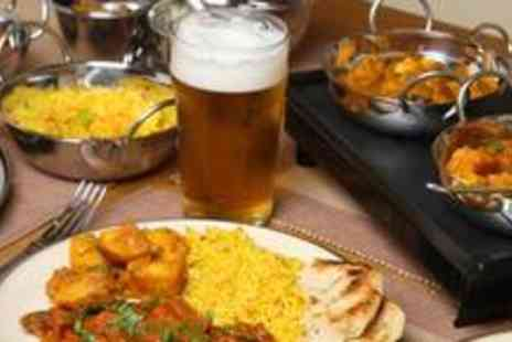 Massala Hut - Indian banquet for two, including a main course, rice, side dish and a glass of beer or wine each - Save 70%