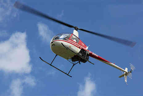 Heli Jet Aviation - Helicopter flying lesson for one person including sparkling wine and a certificate - Save 36%
