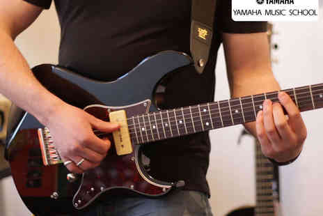 Yamaha Music School  - Four Hour Long Drum, Keyboard, or Guitar Lessons - Save 52%