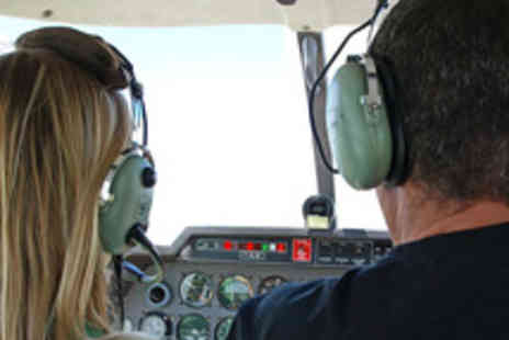 Take Flight Aviation - 30 Minute Private Flying Lesson for One  in a Two Seater Aircraft - Save 50%
