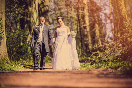 "Olly Clark Photography - Wedding photography package including a DVD, photo booth, photo book and two 10"" x 8"" prints  - Save 53%"