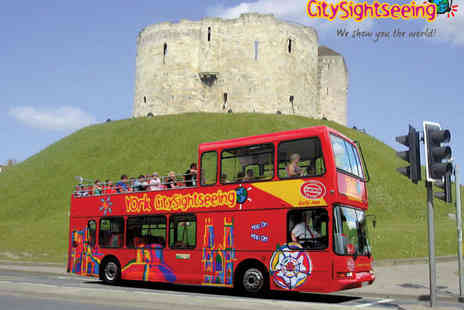City Sightseeing - Hop On Hop Off City Sightseeing Bus Tour for One Child or One Adult at 12 Locations - Save 0%