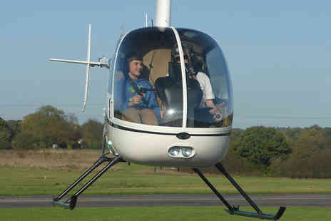 Flying Pig Helicopters -  15 minute helicopter flight for one passenger aged 10 to 17  - Save 51%