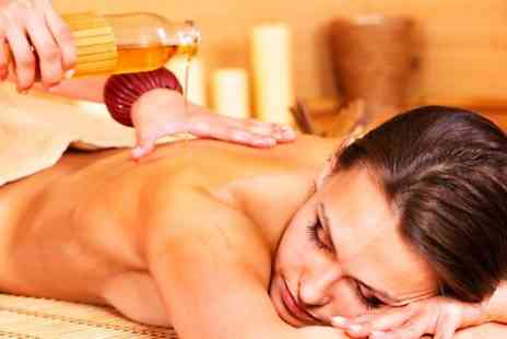 Boutique and Tanning - One Hour Full Body Massage  Plus Facial - Save 55%
