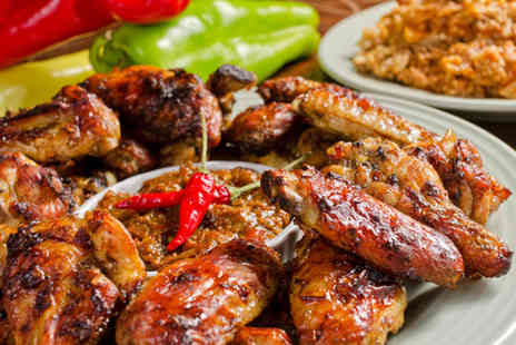 CaribCity - Three course Caribbean meal for two including a glass of wine each   - Save 56%