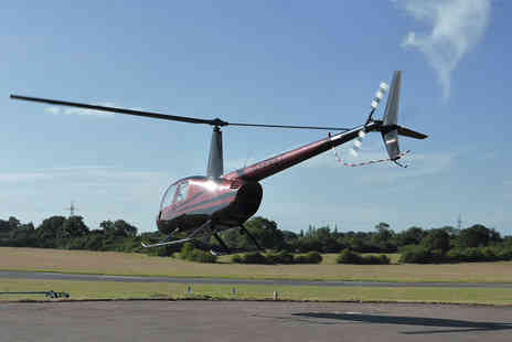 Flying Pig Helicopters - Romantic helicopter flying experience for two and bubbly   - Save 50%