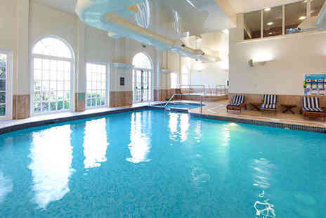 Village Urban Resorts - Spa Day with Choice of Treatments, Coffee and Cake, and Use of Facilities for One  - Save 49%