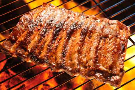 The Blue Steak Restaurant - Foot long rack of ribs each and a bottle of wine or jug of beer to share for two - Save 58%