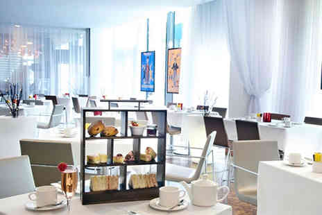 The Hilton Hotel  - Afternoon tea for two including a Champagne cocktail each  - Save 52%