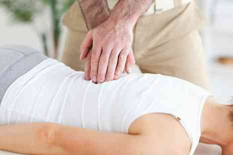 Core Wellness Centres - New Patient Examination Plus a Report of Findings and One Treatments   - Save 83%