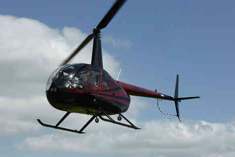 Flying Pig Helicopters - Introductory helicopter flight for one over Eastenders Albert Square and other film locations   - Save 40%