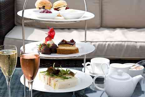The Felbridge Hotel and Spa - Afternoon Tea With a 25 Minute Treatment and Prosecco For One  - Save 46%