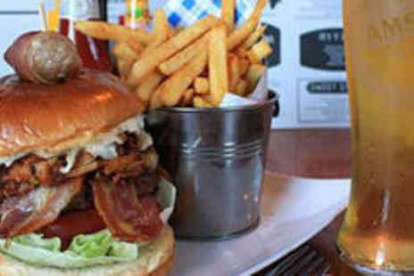 It Bar and Food Joint - Burger or hot dog with beer for two - Save 0%