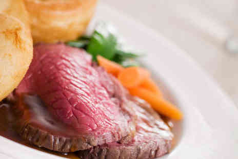 The Clock Cafe - Two Course Sunday Lunch with Glass of Wine and Round of Mini Golf for Two  - Save 49%