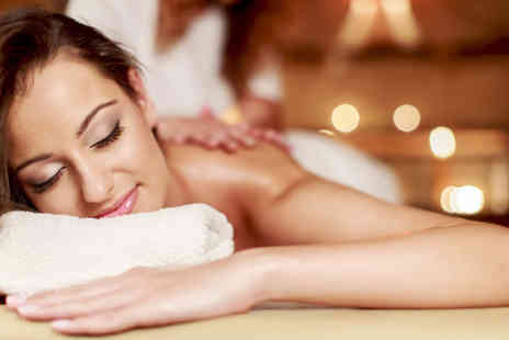 Healing Touch Academy -  60 minute full body exfoliation followed by a hot oil massage including lemongrass tea   - Save 72%