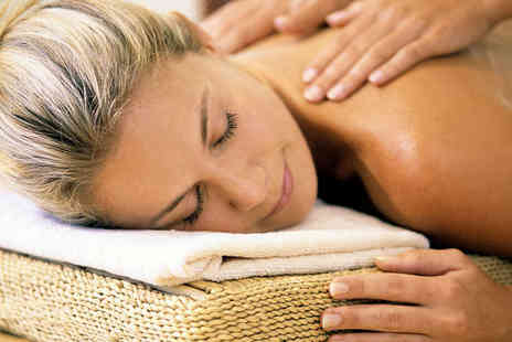 The Coach House - Full Body Massage or Hopi Ear Candle Treatment - Save 51%