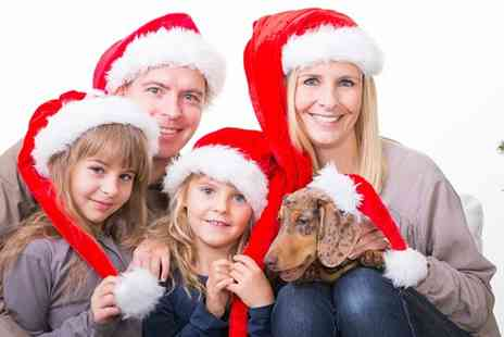 "Arts Photography - Mini Santa photoshoot including two 6"" x 4"" prints  two key rings and a £25 credit  - Save 94%"
